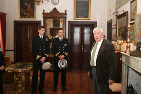 Sr. Francisco Pons Mantonari telling two young officers from HMS Monmouth about the Collingwood House ghost.