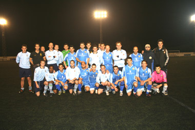 The San Lluis FC and HMS Monmouth teams after the game.