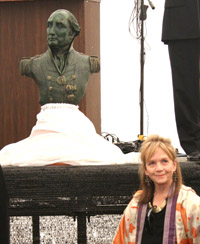 Sculptor Helen Ridehalgh stands besides her bronze bust of Admiral Collingwood at the official unveilling ceremony.