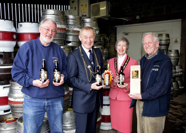 The Lord Mayor Cllr Mike Cookson and Lady Mayoress Mrs Dorrie Cookson, with directors of Northumbria Spirit directors, John Boyle (left) and Jim Golightly at Wylam Brewery.